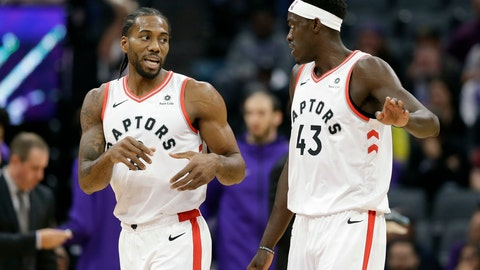 <p>               Toronto Raptors forward Kawhi Leonard, left, talks with teammate Toronto Raptors forward Pascal Siakam during the first quarter of an NBA basketball game against the Sacramento Kings, Wednesday, Nov. 7, 2018, in Sacramento, Calif. (AP Photo/Rich Pedroncelli)             </p>