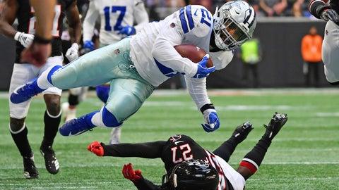 <p>               Dallas Cowboys running back Ezekiel Elliott (21) is tripped by Atlanta Falcons strong safety Damontae Kazee (27) during the first half of an NFL football game, Sunday, Nov. 18, 2018, in Atlanta. (AP Photo/Danny Karnik)             </p>