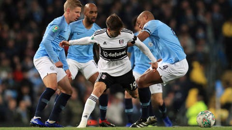 <p>               Fulham's Luciano Vietto is challenged by Manchester City players including Vincent Kompany, right, during their English League Cup, Fourth Round match against Fulham, at the Etihad Stadium in Manchester, England, Thursday Nov. 1, 2018. (Mike Egerton/PA via AP)             </p>