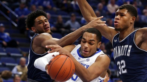 <p>               Kentucky's PJ Washington, middle, gathers in a rebound between Monmouth's Marcus McClary, left, and Diago Quinn (32) during the first half of an NCAA college basketball game in Lexington, Ky., Wednesday, Nov. 28, 2018. (AP Photo/James Crisp)             </p>