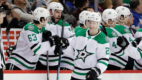 <p>               Dallas Stars' Esa Lindell (23) celebrates with teammates after scoring a goal during the second period of an NHL hockey game against the New York Islanders, Sunday, Nov. 18, 2018, in New York. (AP Photo/Frank Franklin II)             </p>