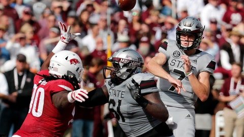 <p>               Mississippi State quarterback Nick Fitzgerald (7) passes against an on rushing Arkansas defender during the first half of an NCAA college football game in Starkville, Miss., Saturday, Nov. 17, 2018. (AP Photo/Rogelio V. Solis)             </p>