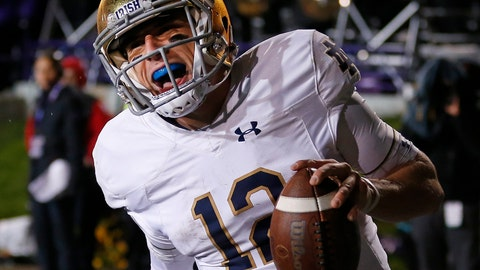 <p>               FILE - In this Saturday, Nov. 3, 2018, file photo, Notre Dame's Ian Book celebrates as he scores a touchdown against Northwestern during the second half of an NCAA college football game in Evanston, Ill. Third-ranked Notre Dame will put its unbeaten record on the line when it faces No. 12 Syracuse at New York's Yankee Stadium on Saturday. (AP Photo/Jim Young, File)             </p>