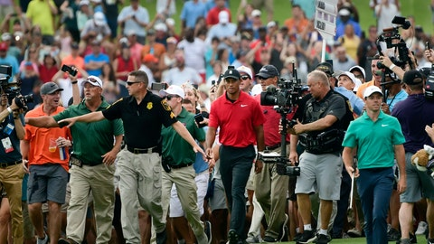 <p>               FILE - In this Sept. 23, 2018, file photo, Tiger Woods, center, and Rory McIlroy, right, make their way down the 18th fairway during the final round of the Tour Championship golf tournament in Atlanta. Woods won the Tour Championship for his 80th career PGA Tour victory, all the evidence he needs for high expectations. He's also wise enough to know his expectations won't be as high as they once were because of age. (AP Photo/John Amis)             </p>
