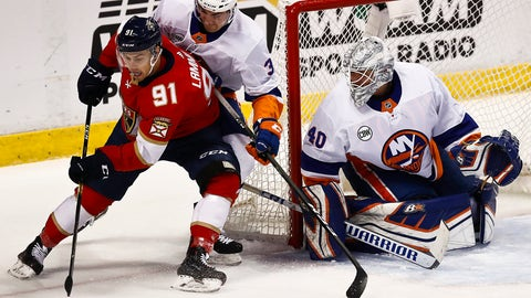 <p>               Florida Panthers right wing Juho Lammikko, left, and New York Islanders defenseman Adam Pelech, right, both go for the puck during the first period of an NHL hockey game on Saturday, Nov. 10, 2018, in Sunrise, Fla. (AP Photo/Brynn Anderson)             </p>