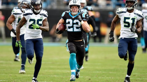 <p>               Carolina Panthers' Christian McCaffrey (22) runs for a long gain past Seattle Seahawks' Shaquill Griffin (26) and Barkevious Mingo (51) during the second half of an NFL football game in Charlotte, N.C., Sunday, Nov. 25, 2018. (AP Photo/Mike McCarn)             </p>