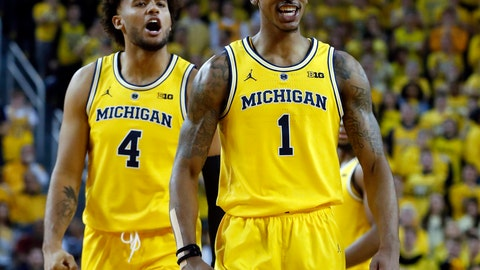 <p>               Michigan guard Charles Matthews (1) celebrates after being fouled while dunking against North Carolina in the second half of an NCAA college basketball game in Ann Arbor, Mich., Wednesday, Nov. 28, 2018. (AP Photo/Paul Sancya)             </p>