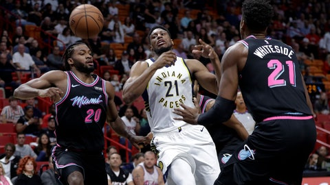 <p>               Indiana Pacers forward Thaddeus Young (21) loses control of the ball as Miami Heat forward Justise Winslow (20) and center Hassan Whiteside (21) defend during the first half of an NBA basketball game Friday, Nov. 9, 2018, in Miami. (AP Photo/Lynne Sladky)             </p>