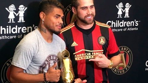 <p>               Atlanta Braves outfielder Ender Inciarte, right, poses with Atlanta United's Josef Martinez, after presentg Martinez with the MLS Golden Boot award during a news conference, Thursday, Nov. 1, 2018, in Marietta, Ga. The Atlanta United striker scored 31 goals this season, easily eclipsing the league record. Both athletes are from Venezuela. (AP Photo/Paul Newberry)             </p>