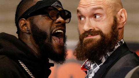 <p>               Boxers Deontay Wilder, left, and Tyson Fury exchange words as they face each other at a news conference in Los Angeles, Wednesday, Nov. 28, 2018. The pair are slated to fight Saturday night for Wilder's WBC heavyweight title. (AP Photo/Damian Dovarganes)             </p>