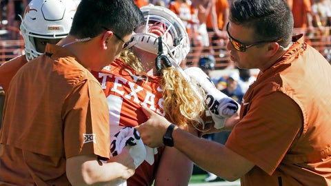 <p>               Texas' Breckyn Hager cries out in pain while being checked by trainers during the first half of an NCAA college football game against West Virginia, Saturday, Nov. 3, 2018, in Austin, Texas. Hager left the field in a sling later in the game. (AP Photo/Michael Thomas)             </p>