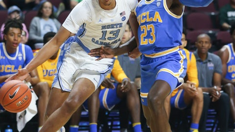 <p>               North Carolina's Cameron Johnson (13) drives the ball around UCLA's Prince Ali (23) during the first half of an NCAA college basketball game Friday, Nov. 23, 2018, in Las Vegas. (AP Photo/Chase Stevens/Las Vegas Review-Journal via AP)             </p>