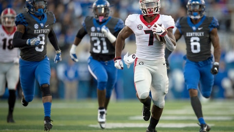 <p>               FILE - In this Saturday, Nov. 3, 2018, file photo, Georgia running back D'Andre Swift (7) runs for a touchdown during the second half an NCAA college football game against Kentucky in Lexington, Ky. The Bulldogs have produced dynamic running backs over the years, from Herschel Walker to Todd Gurley. The trend continues this season with Holyfield and D'Andre Swift.  (AP Photo/Bryan Woolston, File)             </p>