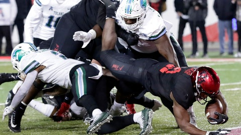 <p>               Houston running back Patrick Carr (21) dives between Tulane safety Roderic Teamer Jr., left, and nose tackle De'Andre Williams, right, during the first half of an NCAA college football game Thursday, Nov. 15, 2018, in Houston. (Michael Wyke/Houston Chronicle via AP)             </p>