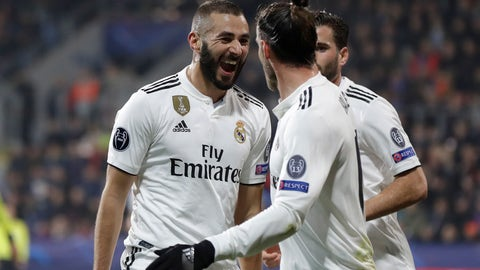 <p>               Real forward Karim Benzema, left, celebrates after scoring his side's third goal during the Champions League group G soccer match between Real Madrid and Viktoria Plzen at the Doosan arena in Pilsen, Czech Republic, Wednesday, Nov. 7, 2018. (AP Photo/Petr David Josek)             </p>