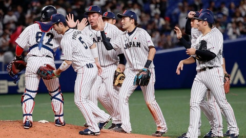 <p>               All Japan catcher Takuya Kai (62) is celebrated by teammates on the mound after beating MLB All-Stars 6-5 in Game 5 at their All-Stars Series baseball at Nagoya Dome in Nagoya, central Japan, Wednesday, Nov. 14, 2018. (Kyodo News via AP)             </p>