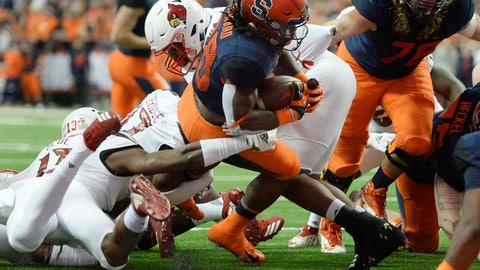 <p>               Syracuse running back Jarveon Howard (28) crosses the goal line for Syracuse touchdown against Louisville during the first half of an NCAA college football game in Syracuse, N.Y., Friday, Nov. 9, 2018. (AP Photo/Adrian Kraus)             </p>