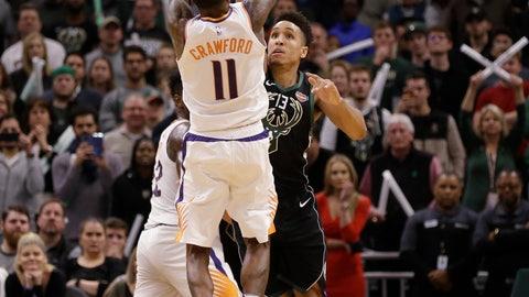 <p>               Phoenix Suns' Jamal Crawford (11) hits the game-winning shot over Milwaukee Bucks' Malcolm Brogdon during the second half of an NBA basketball game Friday, Nov. 23, 2018, in Milwaukee. The Suns won 116-114. (AP Photo/Jeffrey Phelps)             </p>