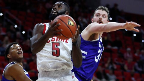 <p>               North Carolina State's Eric Lockett (5) drives by North Carolina Asheville's Jeremy Peck (34) during the first half of an NCAA college basketball game, Tuesday, Nov. 13, 2018 in Raleigh, N.C. (Ethan Hyman/The News & Observer via AP)             </p>
