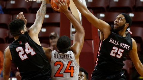 <p>               Virginia Tech's Kerry Blackshear, Jr., center, has his shot blocked against the defense of Ball State's Trey Moses, eft, and Tahjai Teague during the second half of an NCAA college basketball game at the Charleston Classic at TD Arena, Thursday, Nov. 15, 2018, in Charleston, S.C. Virginia Tech won 76-64. (AP Photo/Mic Smith)             </p>