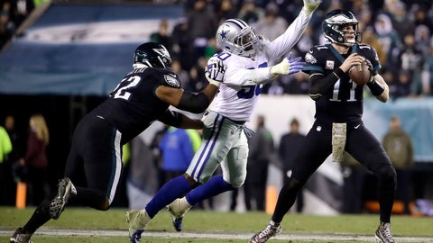 <p>               Philadelphia Eagles quarterback Carson Wentz, right, looks to pass as offensive tackle Halapoulivaati Vaitai, left, tries to block Dallas Cowboys defensive end Demarcus Lawrence during the second half of an NFL football game, Sunday, Nov. 11, 2018, in Philadelphia. (AP Photo/Matt Rourke)             </p>