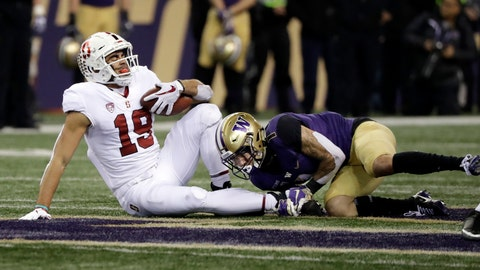 <p>               Stanford's JJ Arcega-Whiteside (19) is tackled by Washington's Byron Murphy after a pass reception during the first half of an NCAA college football game Saturday, Nov. 3, 2018, in Seattle. Arecga-Whiteside left the game with an injury. (AP Photo/Elaine Thompson)             </p>