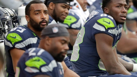 <p>               Seattle Seahawks players, including wide receivers David Moore, right, and Doug Baldwin, upper left, sit on the bench late in the second half of an NFL football game against the Los Angeles Chargers, Sunday, Nov. 4, 2018, in Seattle. (AP Photo/Ted S. Warren)             </p>