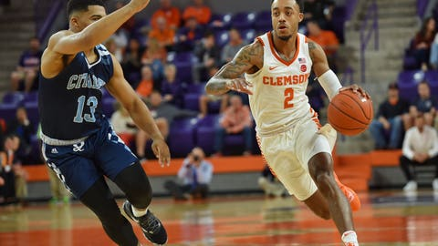 <p>               Clemson's Marcquise Reed dribbles to the basket while defended by The Citadel's Lew Stallworth during the first half of an NCAA college basketball game Tuesday, Nov. 6, 2018, in Clemson, S.C. (AP Photo/Richard Shiro)             </p>