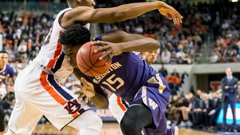 <p>               Washington forward Noah Dickerson (15) challenges Auburn center Austin Wiley (50) during the first half of an NCAA college basketball game, Friday, Nov. 9, 2018, in Auburn, Ala. (AP Photo/Vasha Hunt)             </p>