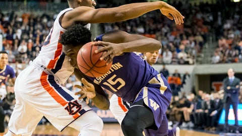 <p>               Washington forward Noah Dickerson (15) challenges Auburn center Austin Wiley (50) during the first half of an NCAA college basketball game, Friday, Nov. 9, 2018, in Auburn, Ala. (AP Photo/Vasha Hunt)             </p>