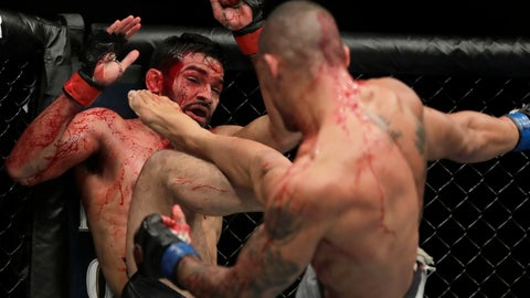 <p>               Sheymon Moraes, right, lands a kick on Julio Arce during the second round of a featherweight mixed martial arts bout at UFC 230 on Saturday, Nov. 3, 2018, at Madison Square Garden in New York. (AP Photo/Julio Cortez)             </p>