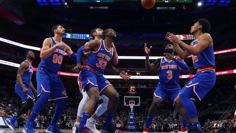 <p>               New York Knicks center Enes Kanter (00), forward Noah Vonleh (32) and guards Tim Hardaway Jr. (3) and Allonzo Trier (14) wait on the ball after the Detroit Pistons scoredduring the first half of an NBA basketball game, Tuesday, Nov. 27, 2018, in Detroit. (AP Photo/Carlos Osorio)             </p>