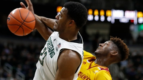 <p>               Michigan State forward Xavier Tillman (23) pulls down a rebound next to Louisiana-Monroe forward Andre Washington (11) during the first half of an NCAA college basketball game Wednesday, Nov. 14, 2018, in East Lansing, Mich. (AP Photo/Carlos Osorio)             </p>