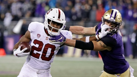 <p>               Stanford's Bryce Love (20) pushes back on Washington's Taylor Rapp on a carry during the second half of an NCAA college football game Saturday, Nov. 3, 2018, in Seattle. Rapp was called for a horse collar on the play. Washington won 27-23. (AP Photo/Elaine Thompson)             </p>