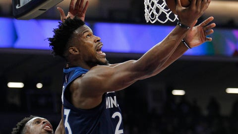 <p>               Minnesota Timberwolves guard Jimmy Butler (23) gets around Sacramento Kings guard Buddy Hield (24) for a basket during the first half of an NBA basketball game in Sacramento, Calif., Friday, Nov. 9, 2018. (AP Photo/Steve Yeater)             </p>