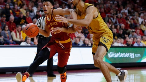 <p>               Iowa State guard Lindell Wigginton, left, drives past Alabama State center Branden Johnson during the first half of an NCAA college basketball game Tuesday, Nov. 6, 2018, in Ames, Iowa. (AP Photo/Charlie Neibergall)             </p>