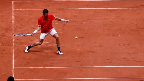 <p>               Croatia's Borna Coric returns the ball to France's Jeremy Chardy during the Davis Cup final between France and Croatia, Friday, Nov. 23, 2018 in Lille, northern France. (AP Photo/Thibault Camus)             </p>
