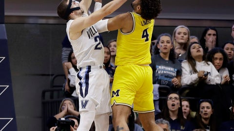 <p>               Michigan's Isaiah Livers, right, goes up for a shot against Villanova's Joe Cremo during the first half of an NCAA college basketball game, Wednesday, Nov. 14, 2018, in Villanova. (AP Photo/Matt Slocum)             </p>