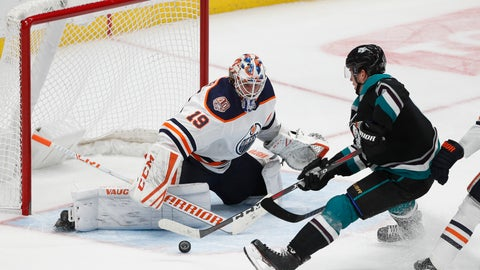<p>               Anaheim Ducks' Rickard Rakell, right, of Sweden, moves the puck to score against Edmonton Oilers goaltender Mikko Koskinen, of Finland, in overtime of an NHL hockey game Friday, Nov. 23, 2018, in Anaheim, Calif. The Ducks won 2-1 in overtime. (AP Photo/Jae C. Hong)             </p>
