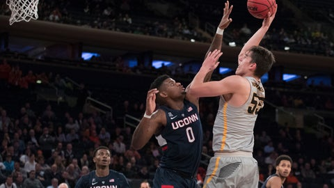 <p>               Iowa forward Luka Garza (55) shoots over Connecticut forward Eric Cobb (0) during the first half of an NCAA college basketball final game in the 2K Empire Classic, Friday, Nov. 16, 2018, at Madison Square Garden in New York. (AP Photo/Mary Altaffer)             </p>