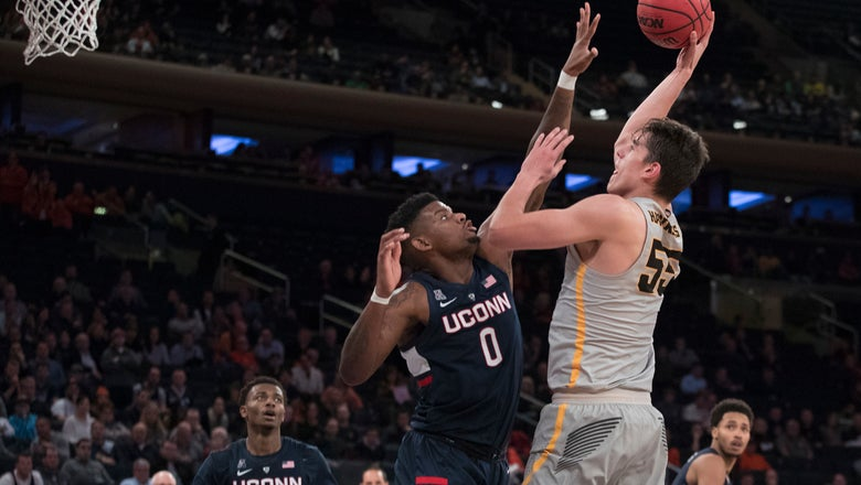 The Latest: Iowa beats UConn for 2K Classic title