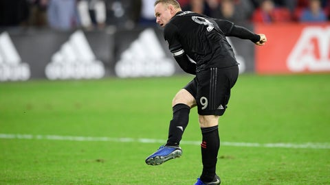 <p>               D.C. United forward Wayne Rooney follows through on his kick during a penalty kick shootout of an MLS playoff soccer match against the Columbus Crew, Thursday, Nov. 1, 2018, in Washington. Rooney's kick as saved by Columbus goalkeeper Zack Steffen. Columbus won 3-2 on penalty kicks. (AP Photo/Nick Wass)             </p>