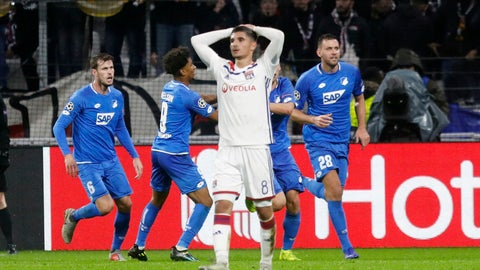 <p>               Lyon midfielder Houssem Aouar, center, reacts as Hoffenheim players celebrate their side's 2nd goal during a Champions League group F soccer match between Lyon and Offenheim in Decines, near Lyon, central France, Wednesday, Nov. 7, 2018. (AP Photo/Laurent Cipriani)             </p>