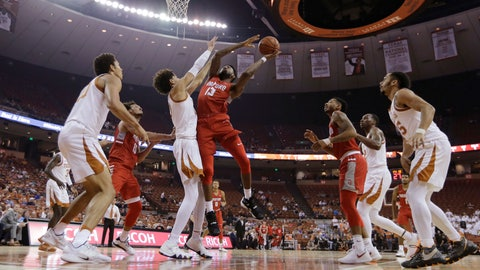<p>               Radford forward Leroy Butts IV (13) tries to shoot over Texas forward Jaxson Hayes during the first half of an NCAA college basketball game Friday, Nov. 30, 2018, in Austin, Texas. (AP Photo/Eric Gay)             </p>