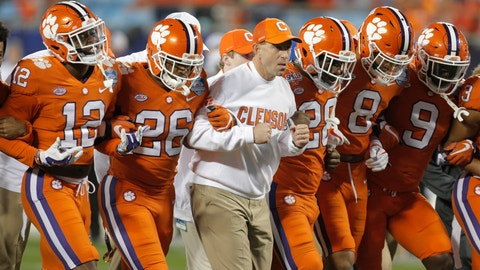 <p>               FILE - In this Dec. 2, 2017, file photo, Clemson head coach Dabo Swinney, center, links arms with players as they march on the field before the Atlantic Coast Conference championship NCAA college football game against Miami in Charlotte, N.C. The second-ranked Tigers will face Pittsburgh for the ACC title on Saturday night. Swinney says the ACC title game experience will help the Tigers.  (AP Photo/Bob Leverone, File)             </p>
