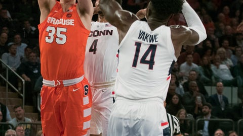 <p>               Syracuse guard Buddy Boeheim (35) goes to the basket against Connecticut forward Kassoum Yakwe (14) and guard Jalen Adams (4) during the first half of an NCAA college basketball game in the 2K Empire Classic, Thursday, Nov. 15, 2018, at Madison Square Garden in New York. (AP Photo/Mary Altaffer)             </p>