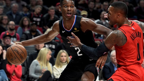 <p>               Los Angeles Clippers guard Shai Gilgeous-Alexander, left, tries to get past Portland Trail Blazers guard Damian Lillard, right, during the first half of an NBA basketball game in Portland, Ore., Thursday, Nov. 8, 2018. (AP Photo/Steve Dykes)             </p>