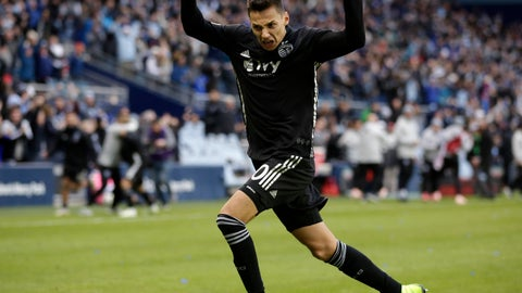 <p>               Sporting Kansas City forward Daniel Salloi celebrates after scoring a goal during the second half of a MLS Western Conference semifinals soccer match against Real Salt Lake in Kansas City, Kan., Sunday, Nov. 11, 2018. Sporting KC defeated Real Salt Lake 4-2. (AP Photo/Colin E. Braley)             </p>
