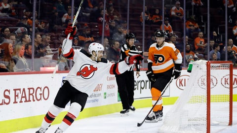 <p>               New Jersey Devils' Blake Coleman, left, reacts past Philadelphia Flyers' Christian Folin after a goal by Joey Anderson during the first period of an NHL hockey game, Thursday, Nov. 15, 2018, in Philadelphia. (AP Photo/Matt Slocum)             </p>