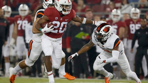 <p>               CORRECTS DATE - Stanford running back Bryce Love (20) stiff arms Oregon State cornerback Shawn Wilson (2) as he rushes for a touchdown in the first half during an NCAA college football game on Saturday, Nov. 10, 2018, in Stanford, Calif. (AP Photo/Tony Avelar)             </p>